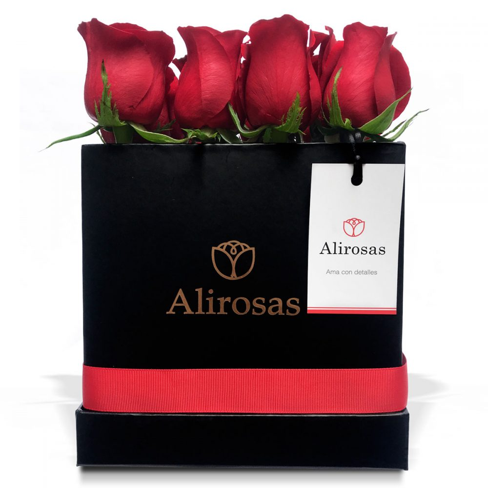 Box con 16 rosas rosadas: arreglo floral